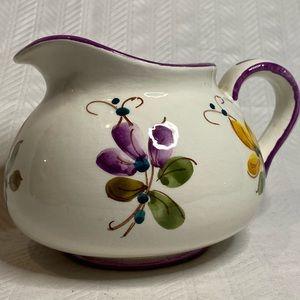 Vintage floral colorful porcelain pitcher.